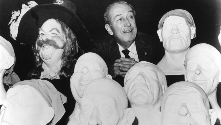 Walt Disney sits among sculpted models that were the basis of the moving figures in the Pirates of the Caribbean ride. The ride debuted March 18, 1967, three months after Disney died.