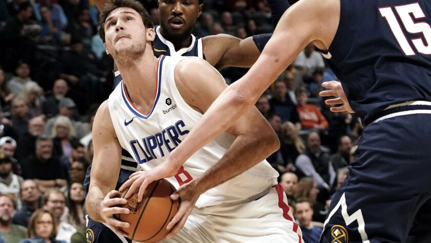 Los Angeles Clippers forward Danilo Gallinari (8) has the ball slapped away by Denver Nuggets center