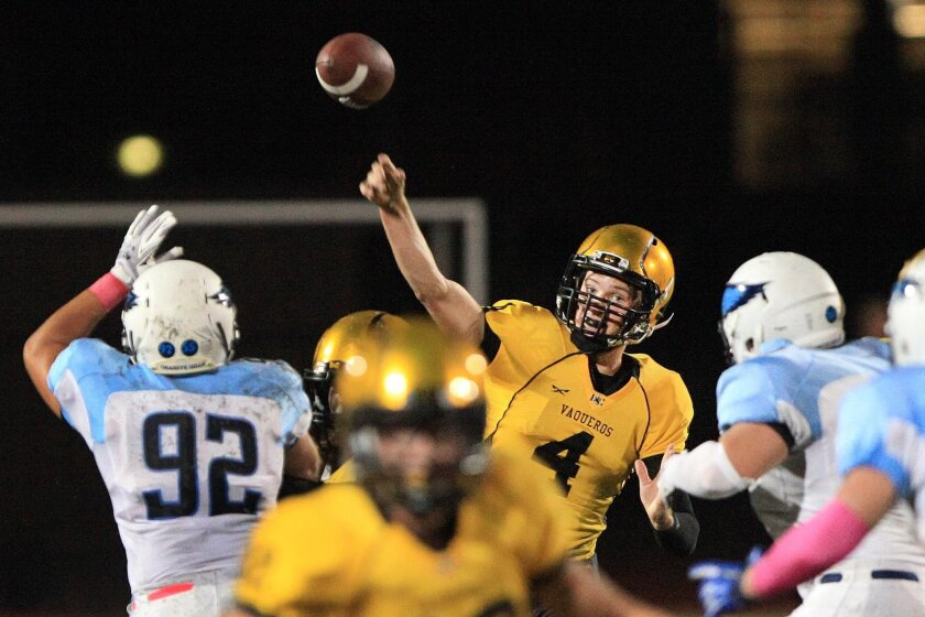 El Capitan quarterback Brad Cagle lets a pass fly against Granite Hills. The Vaqueros are among the county's top-scoring teams with 42.5 points a game.