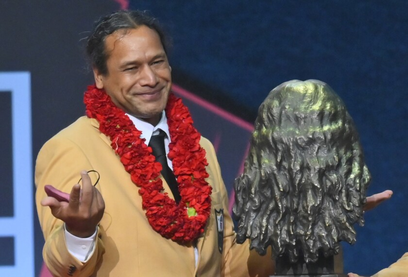 Troy Polamalu, a member of the Pro Football Hall of Fame Centennial Class, smiles after his bust was unveiled during the induction ceremony at the Pro Football Hall of Fame, Saturday, Aug. 7, 2021, in Canton, Ohio. (AP Photo/David Richard)