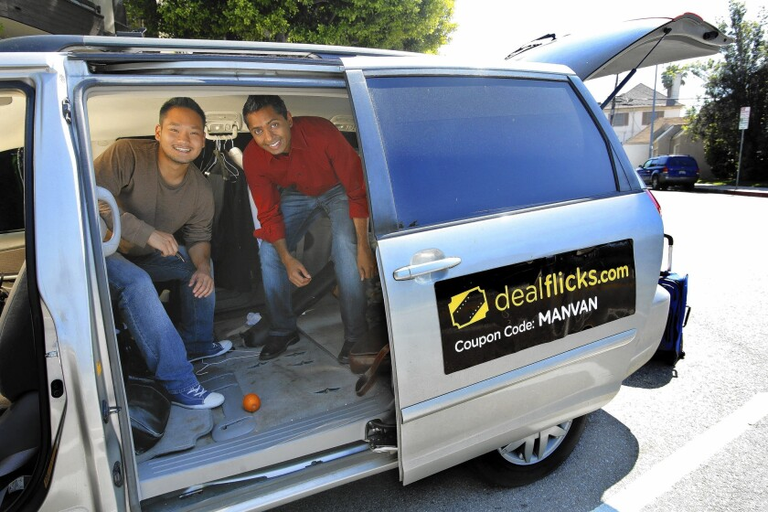 Dealflicks co-founders Kevin Hong, left, and Sean Wycliffe are inside a converted minivan the company uses to travel around the country and meet with theater owners.