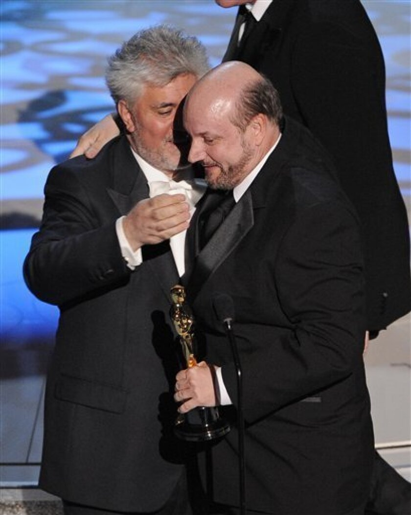 "Director Juan Jose Campanella, right, accepts the Oscar for best foreign language film of the year for ""El Secreto de Sus Ojos"" from fellow Argentine Pedro Almodovar at the 82nd Academy Awards Sunday, March 7, 2010, in the Hollywood section of Los Angeles. (AP Photo/Mark J. Terrill)"