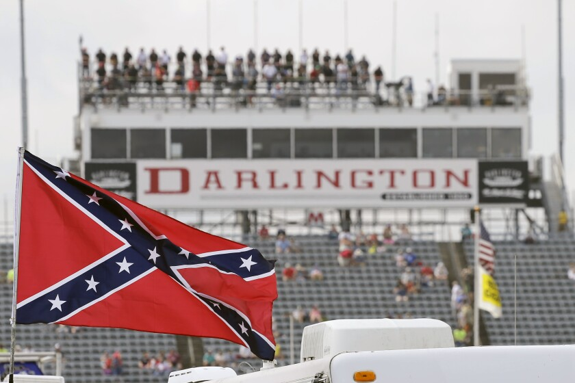 A Confederate flag flies in the infield at Darlington Raceway before a NASCAR Xfinity Series race Sept. 5, 2015.