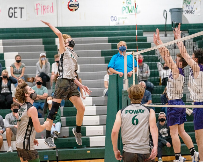 Poway High's Brett Pursley hitting the volleyball during a game against Carlsbad.