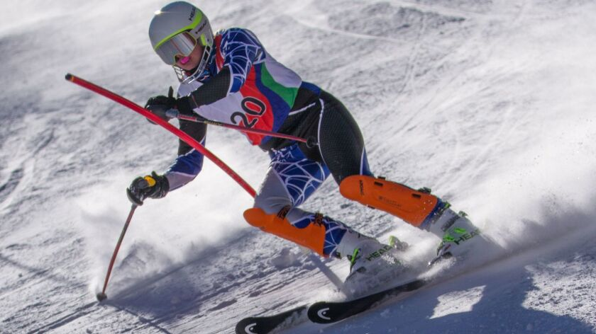 Katrina Schaber, an adaptive standing alpine skier from Carlsbad, hopes to compete in the 2018 Winter Paralympics in South Korea in March. She is seen here racing slalom in World Cup competition.