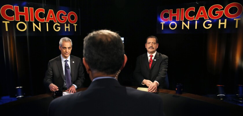 """Chicago Mayor Rahm Emanuel, left, and challenger Cook County Commissioner Jesus """"Chuy"""" Garcia during the March 31 televised mayoral debate, the last one ahead of Tuesday's runoff election."""
