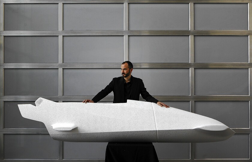Michael Scully stands with one of the first foam mockups of the BMW bobsled designed for Team USA at in Newbury Park.