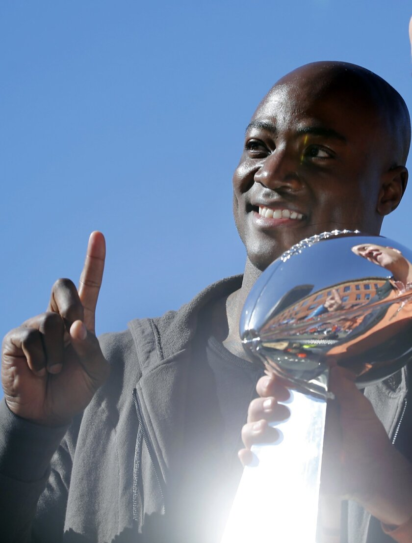 Denver Broncos defensive end DeMarcus Ware poses with the Lombardi Trophy during a parade for the NFL football Super Bowl champions, Tuesday, Feb. 9, 2016, in Denver. (AP Photo/Jack Dempsey)