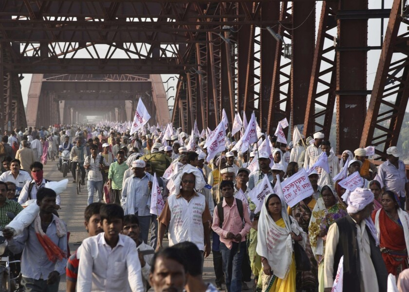 Hindu pilgrims cross a crowded bridge that was the scene earlier of a deadly stampede outside Varanasi, India, on Saturday.