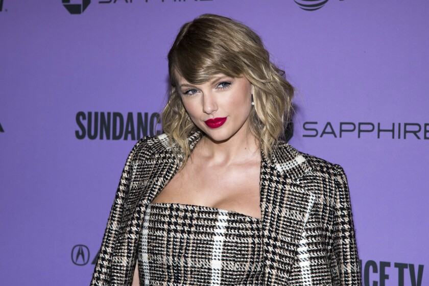 """FILE - In a Jan. 23, 2020 file photo, Taylor Swift attends the premiere of """"Taylor Swift: Miss Americana"""" at the Eccles Theater during the 2020 Sundance Film Festival in Park City, Utah. Swift is coming back to her roots with a performance at this year's Academy of Country Music Awards. The nine-time ACM award winner will perform from the Grand Ole Opry House in Nashville, Tennessee, where the awards show will be broadcast Wednesday, Sept. 16, 2020 on CBS. (Photo by Charles Sykes/Invision/AP, File)"""