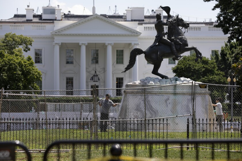 The President Andrew Jackson statue is washed in Lafayette Park on June 24.