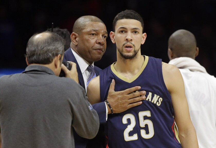 Clippers Coach Doc Rivers, left, hugs his son, New Orleans guard Austin Rivers, after L.A. beat the Pelicans, 120-100, on Dec. 6 at Staples Center.
