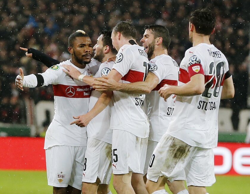 Stuttgart's players celebrate their side's equalizing goal during a quarterfinal match of the German soccer cup between VfB Stuttgart and Borussia Dortmund in Stuttgart, Germany, Tuesday, Feb. 9, 2016. (AP Photo/Michael Probst)