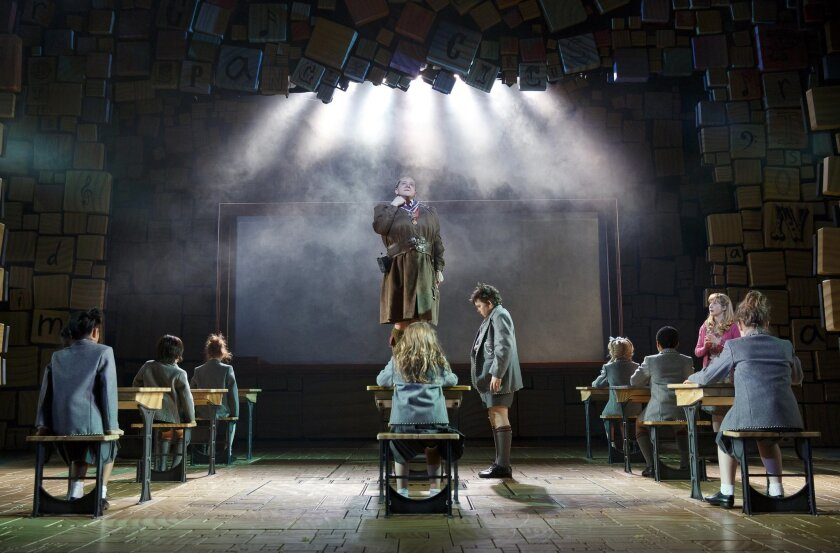 """This theater publicity image released by Boneau/Bryan-Brown shows the cast of """"Matilda, the Musical,"""" including Bertie Carvel, standing center, during a performance in New York. A national tour if """"Matilda the Musical"""" will begin in May 2015 at the Ahmanson Theatre in Los Angeles before stops at the SHN Orpheum Theatre in San Francisco, Seattle's 5th Avenue Theatre and Dallas' AT&T Performing Arts Center. (AP Photo/Boneau/Bryan-Brown, Joan Marcus, File)"""