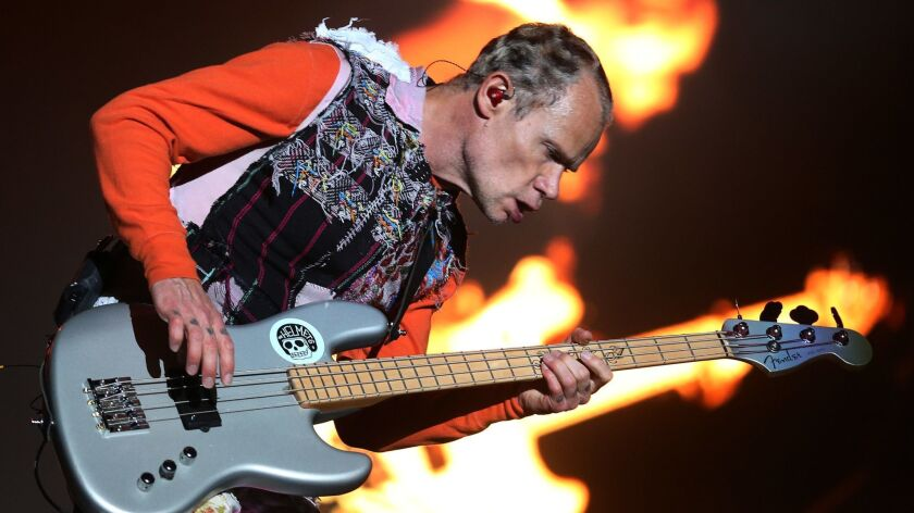 Flea performing with the Red Hot Chili Peppers in March 2018.