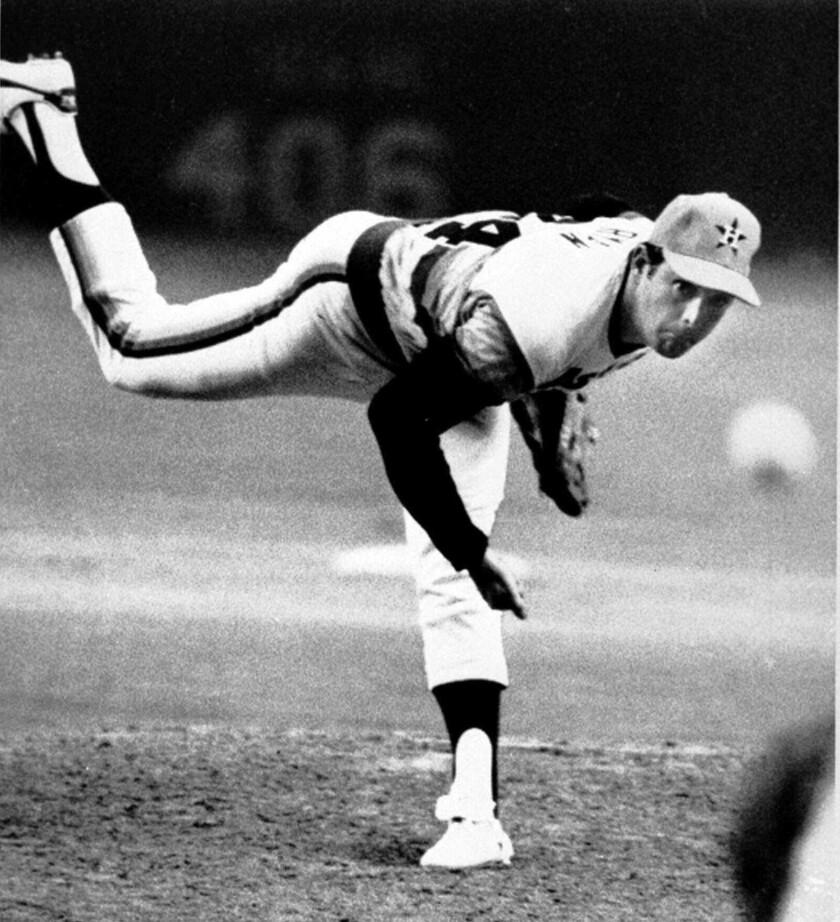 Astros pitcher Nolan Ryan unleashes a pitch.