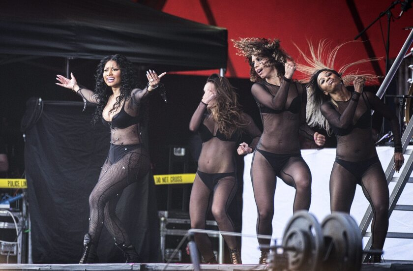 Nicki Minaj, left, performs with dancers at the annual Roskilde Festival, in Roskilde, Denmark, on July 4.