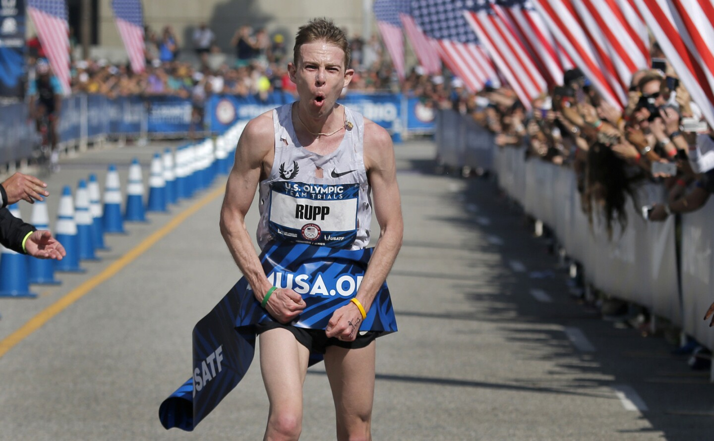 Galen Rupp of Portland, Ore., celebrates his victory after crossing the finish line in the U.S. Olympic men's marathon trial on Saturday in downtown Los Angeles.