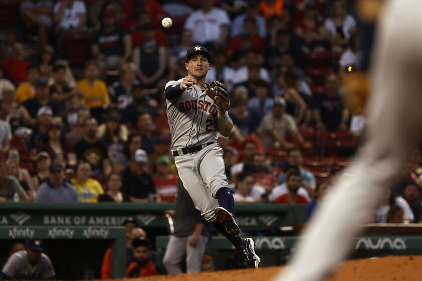 Houston Astros third baseman Alex Bregman throws out a Boston baserunner during the second inning of a baseball game Tuesday, June 8, 2021, at Fenway Park in Boston. (AP Photo/Winslow Townson)