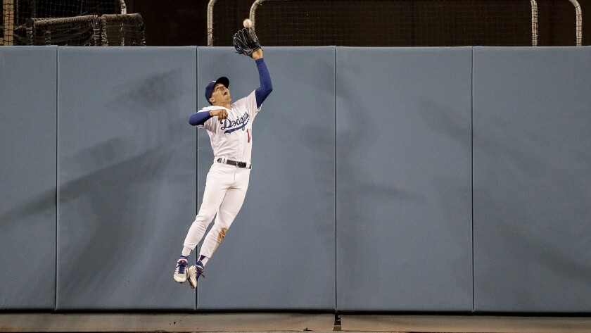 LOS ANGELES, CA, SUNDAY, APRIL 1, 2018 - Dodgers centerfielder Enrique Hernandez makes a leaping cat