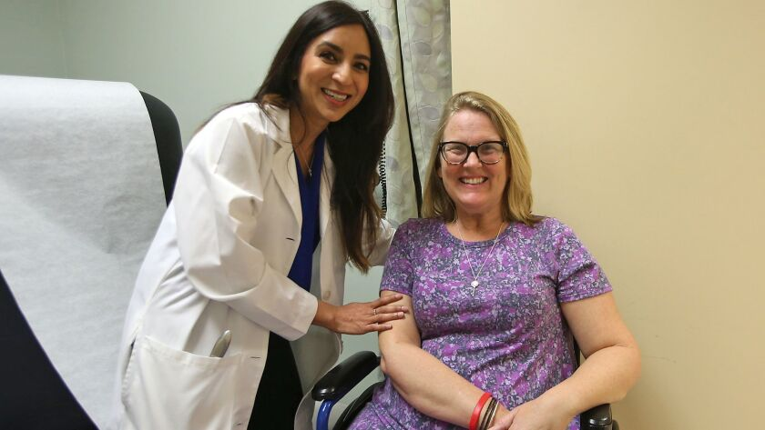 Dr. Namita Goyal, left, a UC Irvine neurologist, and patient Lisa Wittenberg are part of a nationwide study on ALS with UC Irvine.