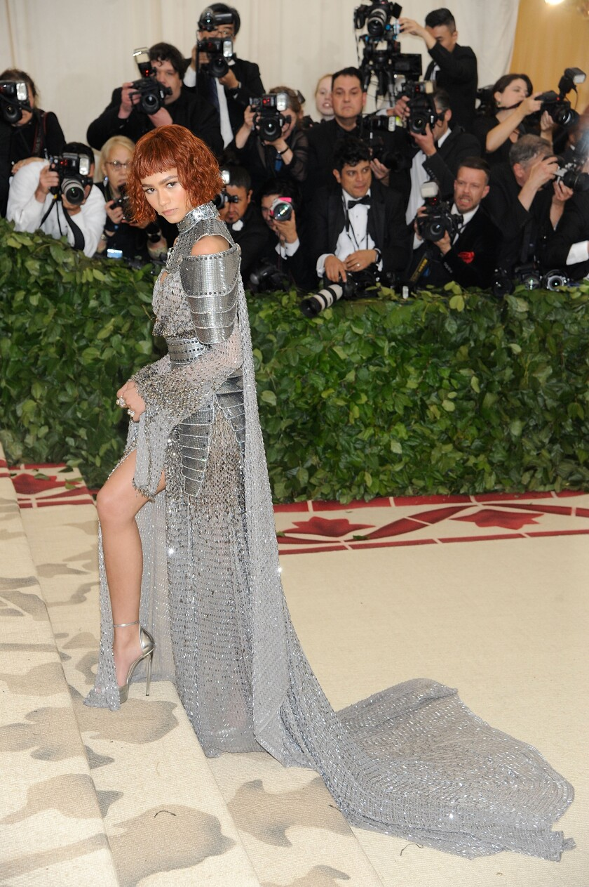 Zendaya wears a  Joan of Arc-inspired custom metallic Versace gown with chainmail touches at the 2018 Met Gala