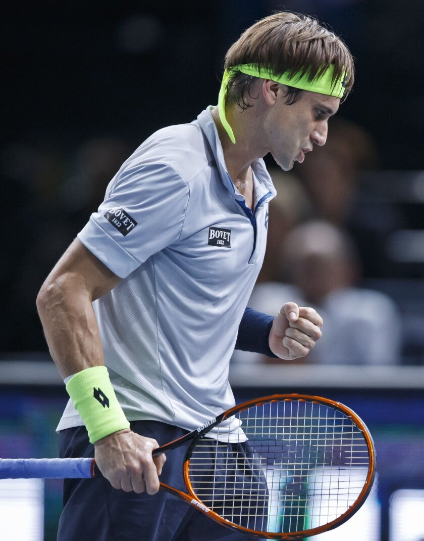 David Ferrer of Spain celebrates after making a point against John Isner of the U.S. during their quarterfinal match of the BNP Masters tennis tournament at the Paris Bercy Arena, in Paris, France, Friday, Nov. 6, 2015. (AP Photo/Michel Euler)