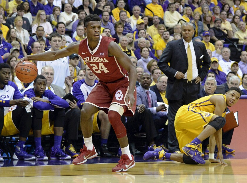 Oklahoma guard Buddy Hield comes up with the loose ball as LSU guard Jalyn Patterson hits the floor during the first half of a game on Jan. 30.