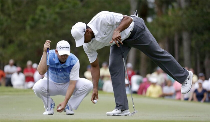 """Tiger Woods, right, says of a spat involving Sergio Garcia that """"it's time to move on."""""""