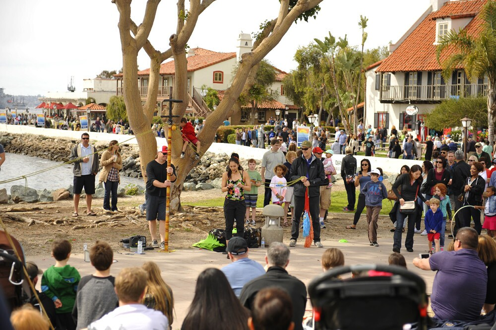 Street performers of all kinds gathered in Seaport Village to perform their arts, including knife throwing, hoola-hooping and juggling on unicycles at the annual Spring Busker Festival on Sunday, March 5, 2017.
