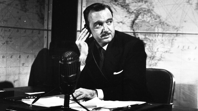 "Walter Cronkite sits at his desk during the CBS Television series ""You Are There"" on Feb. 3, 1953."