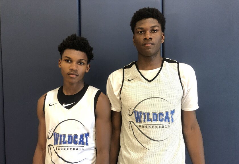 Sophomore point guard Dylan Andrews (left) and sophomore 6-foot-8 Kijani Wright have been important players for Windward in the early season.