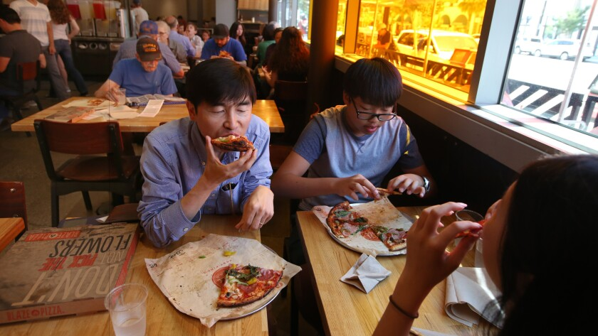 The Lee family digs in at Blaze Pizza's Pasadena location.