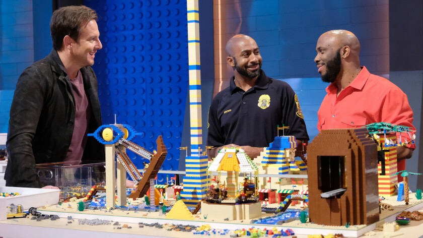 """Will Arnett, left, with two contestants in """"Lego Masters"""" on Fox."""