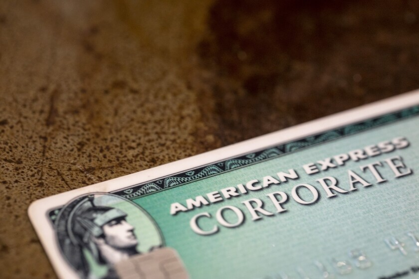FILE - This Aug. 11, 2019 file photo shows an American Express card in New Orleans. American Express' fourth-quarter profits dropped by 39%, the credit card giant said Friday, Oct. 23, 2020, as the pandemic's deep impacts on travel, entertainment and dining dramatically impacted the company's results. (AP Photo/Jenny Kane)