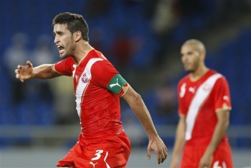 Tunisia's Karim Haggui reacts to his team's 1-1 draw against Zambia following their African Cup of Nations Group D soccer match at Tundavala Stadium in Lubango, Angola Wednesday, Jan. 13, 2010. (AP Photo/Rebecca Blackwell)