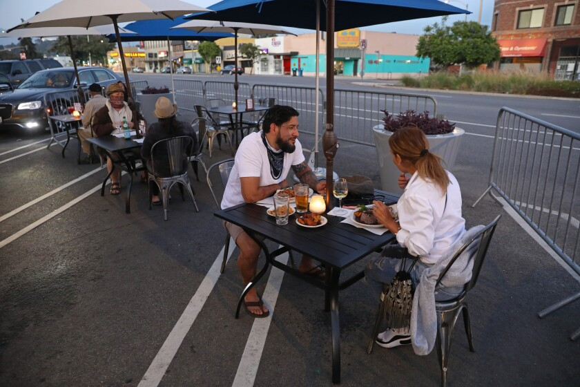 Brandon Astudillo and his wife, Rose Astudillo, of Glendale, dine outdoors at Baracoa Cuban Cafe in Atwater Village.
