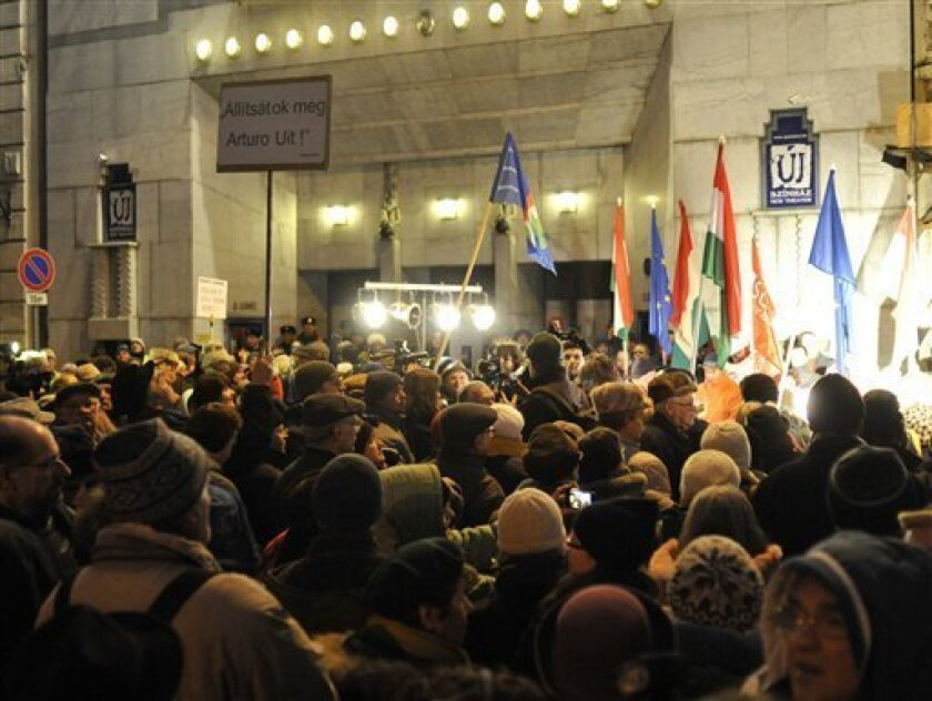 An anti government group protests against the newly appointed far-right director of one of Budapest's leading theatres, the Uj Szinhaz in front of its entrance in Budapest, Hungary, Wednesday, Feb. 1, 2012. The mayor of Budapest sacked the director of theatre and appointed actor Gyoergy Doerner who supports the anti-Roma, anti-gay and anti-Semitic party Jobbik. Banner reads in Hungarian: Stop Arturo Ui! (AP Photo/Bela Szandelszky)