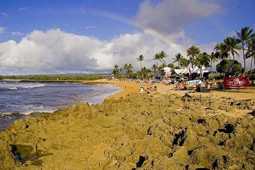 A rainbow over Haleiwa, the gateway to the North Shore and the first stop on the Vans Triple Crown of Surfing.