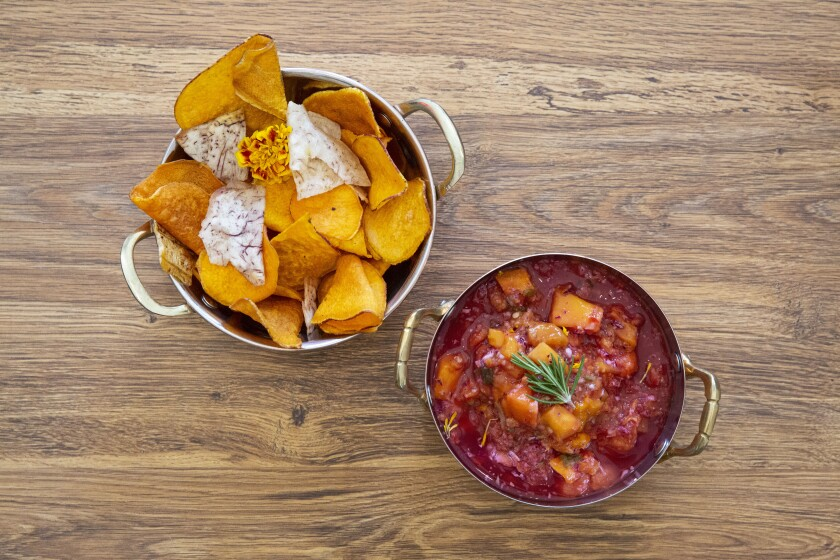 Yuca and sweet potato chips with mango salsa