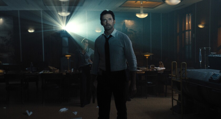"""This image released by Warner Bros. Pictures shows Hugh Jackman in a scene from """"Reminiscence."""" (Warner Bros. Pictures via AP)"""
