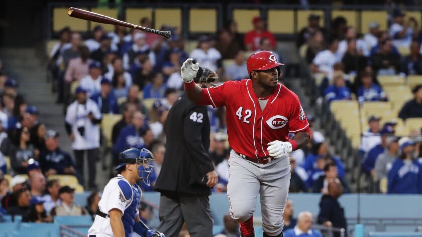 LOS ANGELES, CA - APRIL 15, 2019: Cincinnati Reds Yasiel Puig flips his bat after hitting a 2-run ho