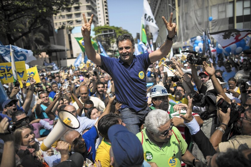 Presidential candidate Aecio Neves campaigns at Rio De Janeiro's Copacabana on Oct. 19. He has criticized President Dilma Rousseff over the Petrobras corruption scandal.