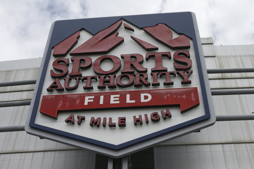 In this Thursday, May 26, 2016, photograph, the sign for Sports Authority Field at Mile High is shown on the south end of the stadium that is the home of the NFL football team Denver Broncos in Denver. The demise of Sports Authority has reignited a fight in Colorado over the future of the Denver Br