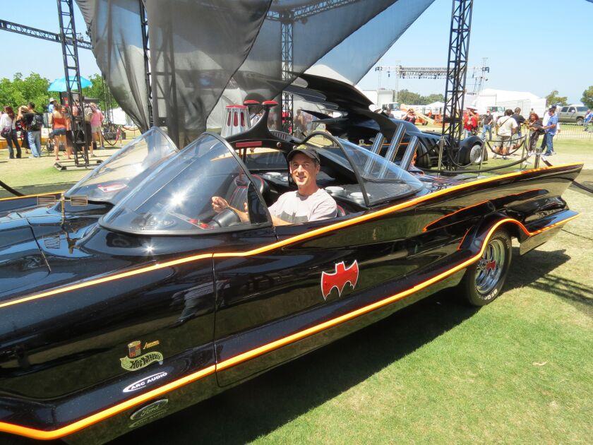 Jordan B. Gorfinkel sits in the Batmobile in San Diego.