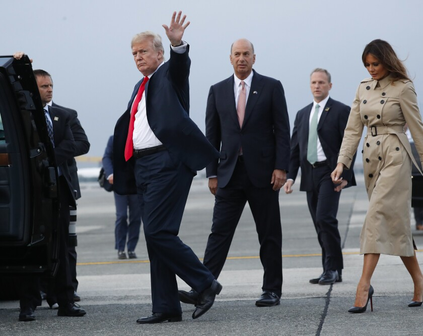 President Trump walks with Gordon Sondland, center, and First Lady Melania Trump in Brussels in 2018.