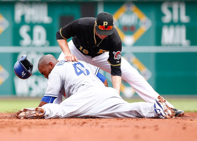 The Dodgers' Howie Kendrick beats the tag of Pirates second baseman Neil Walker during a pickoff attempt at second base in the second inning of their game Saturday in Pittsburgh. No review needed on this play.