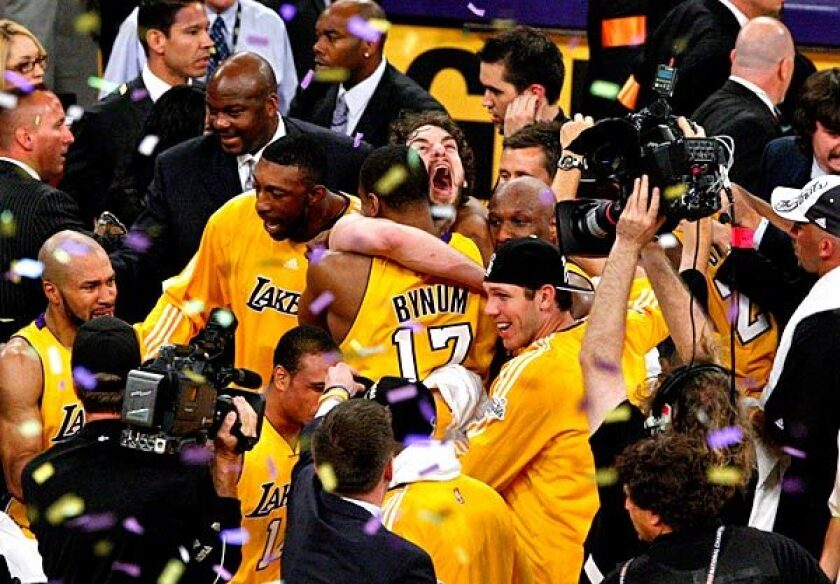 Big men Pau Gasol and Andrew Bynum embrace in the middle of the Lakers' celebration at Staples Center after an 83-79 victory over the Boston Celtics in Game 7 of the 2010 NBA Finals.