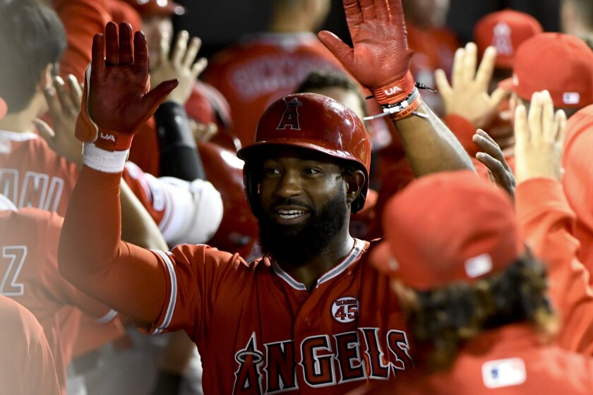 Brian Goodwin celebrates in the Angels' dugout after hitting a two-run home run against the Chicago White Sox on Friday.