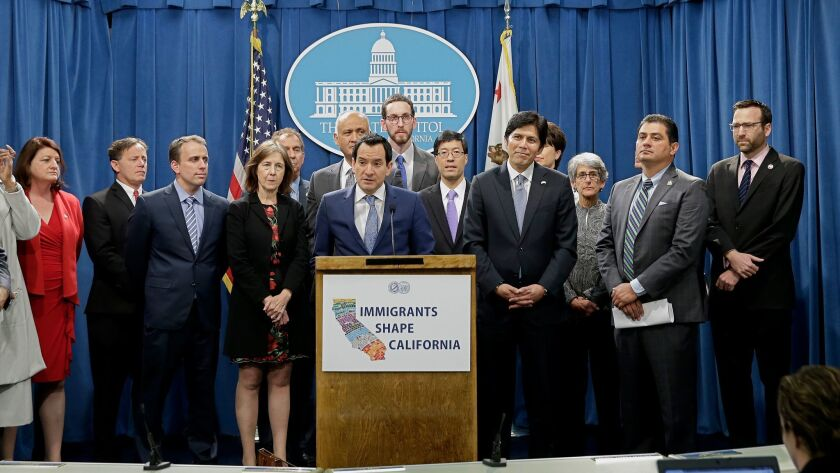 Assembly Speaker Anthony Rendon, D-Paramount, center, discusses a pair of proposed measures to prote